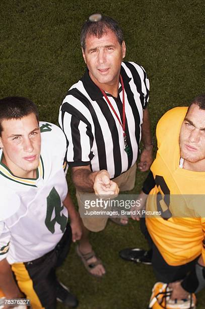 referee tossing coin in front of football players - american football judge stock pictures, royalty-free photos & images