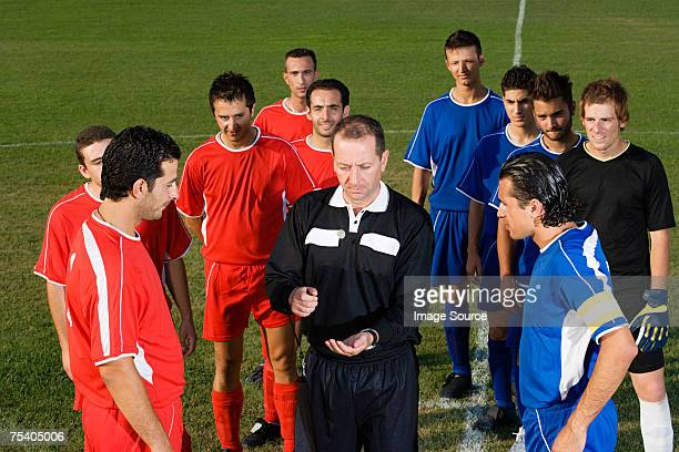 referee tossing coin - flipping a coin stock pictures, royalty-free photos & images