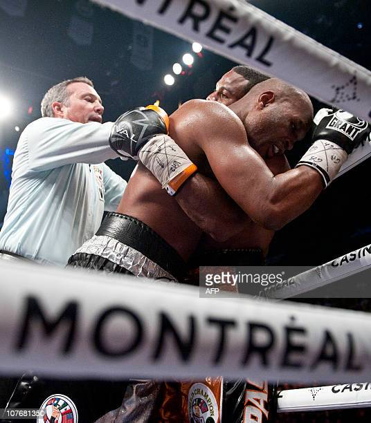 Referee tries to separate Jean Pascal and Bernard Hopkins on round 6 during the WBC Light Heavyweight World Championship at the Pepsi Coliseum in...