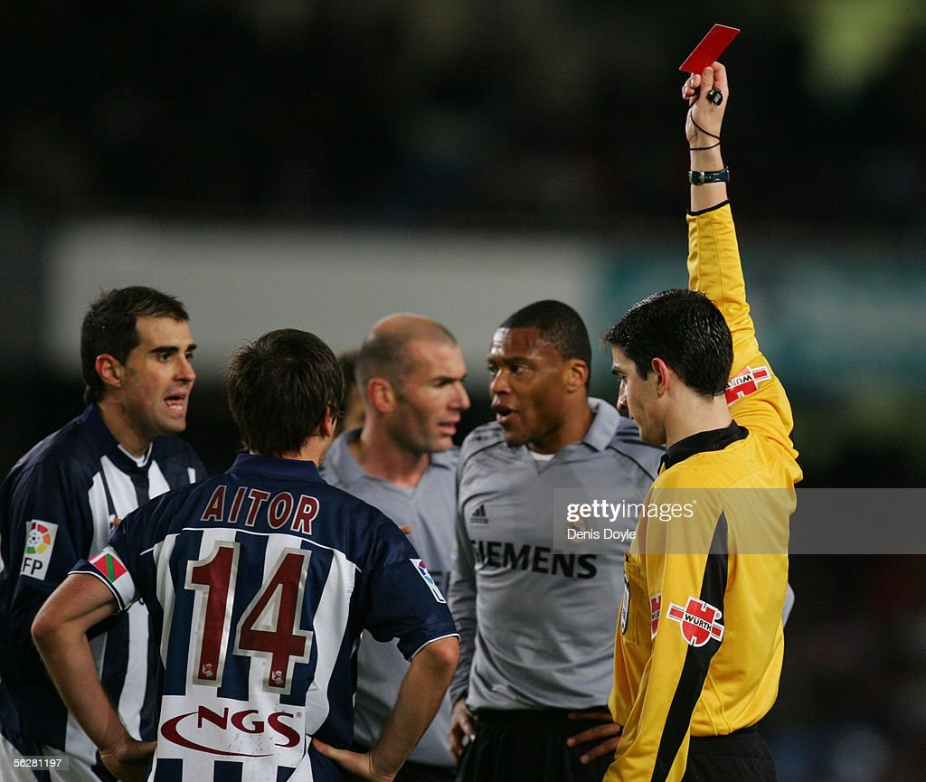 Referee Undiano Mallenco sends off Gaizka Garito (L) of Real Sociedad during a Primera Liga match between Real Sociedad and Real Madrid at the Anoeta stadium on November 27, 2005 in San Sebastian, Spain.