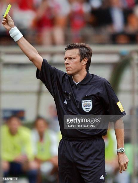 Referee Urs Meier of Switzerland gives a yellow card out to US defender Jeff Agoos in their Group D match at the 2002 FIFA World Cup Korea/Japan in...