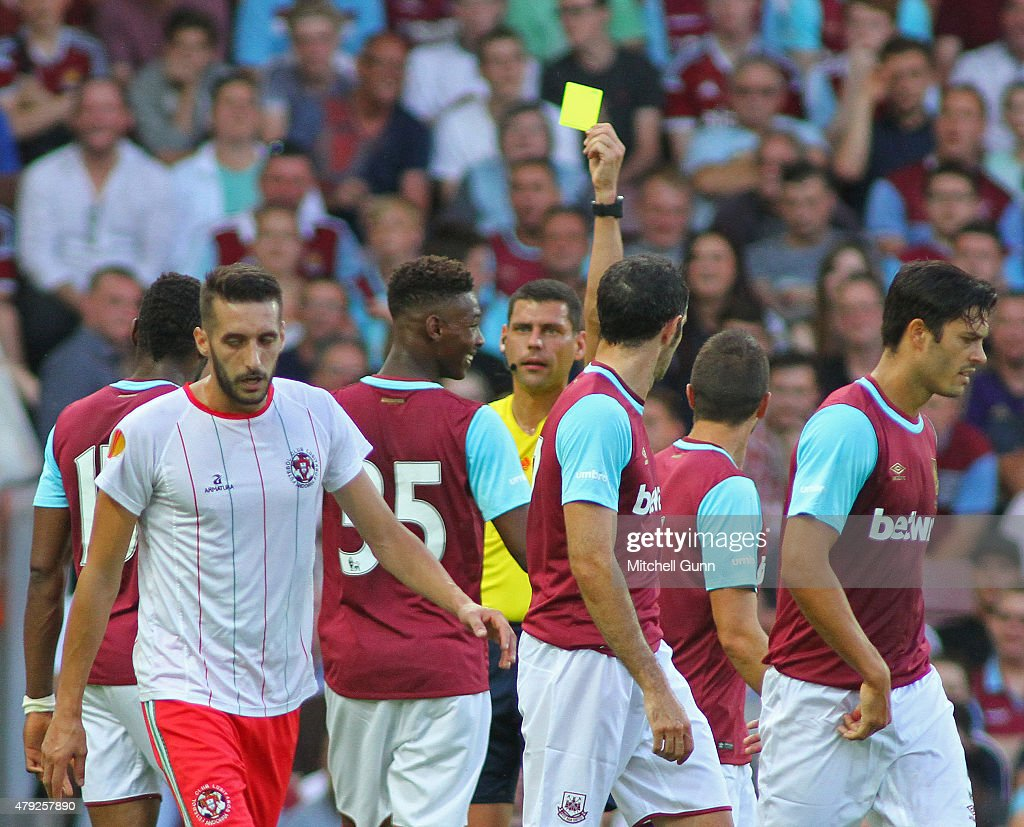 Referee Vadims Direktorenko shows a yellow card to Reece Oxford of West Ham during the UEFA Europa League match between West Ham United and FC Lusitans at Boleyn Ground on July 2, 2015 in London, England.