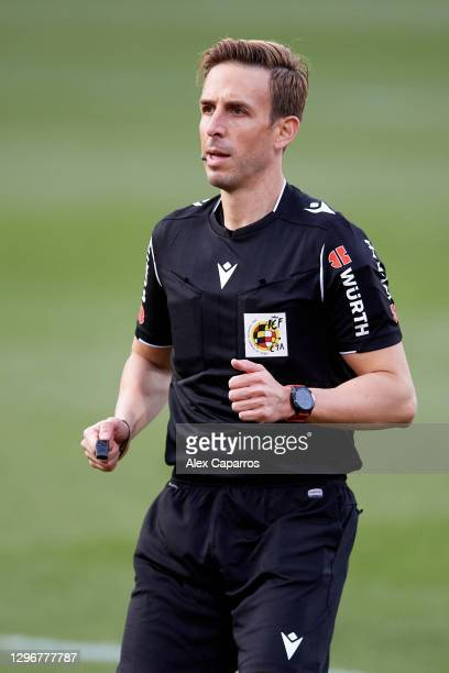 Referee Valentin Pizarro Gomez looks on during the Copa del Rey round of 32 match between Girona FC and Cadiz CF at Montilivi Stadium on January 16,...
