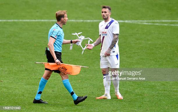 Referee Valentin Pizarro Gomez removes a drone from the pitch during the La Liga Santander match between Athletic Club and SD Eibar at Estadio de San...