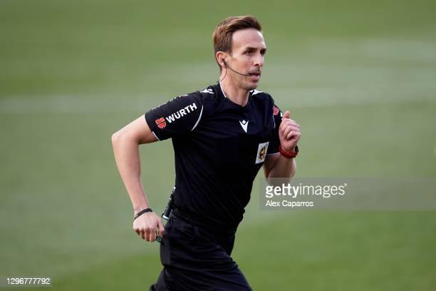 Referee Valentin Pizarro Gomez runs during the Copa del Rey round of 32 match between Girona FC and Cadiz CF at Montilivi Stadium on January 16, 2021...