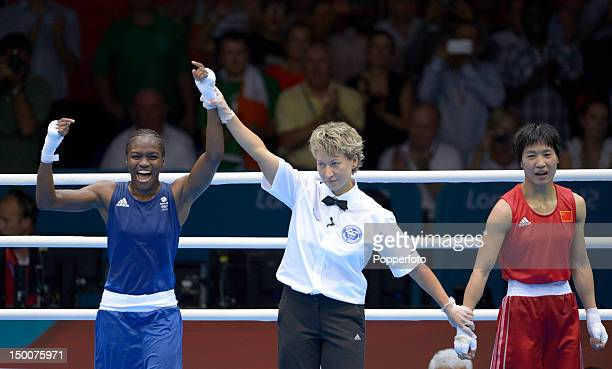 Referee Veronika Szucs announces Nicola Adams of Great Britain winner against Cancan Ren of China during the Women's Fly Boxing final bout on Day 13...