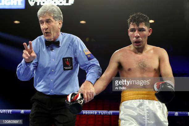 Referee Vic Drakulich holds the hand of Alberto Guevara during his featherweight bout against Isaac Lowe on February 22 2020 at MGM Grand Garden...