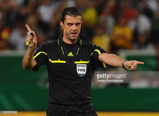 FIFA referee Victor Kassai gestures during the International Friendly match between Germany and Brazil at MercedesBenz Arena on August 10 2011 in...