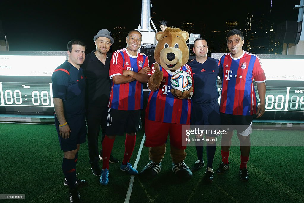 Referee Victor Paredes, DJ Hapa, FC Bayern Munich legend Paulo Sergio, FCBM mascot, referee Marcel Gurujan and FC Bayern Munich legend Giovane Elber pose for a photo at the Audi Soccer Pick-Up Game at Pier 2 at Brooklyn Bridge Park on July 30, 2014 in Brooklyn borough of New York City.
