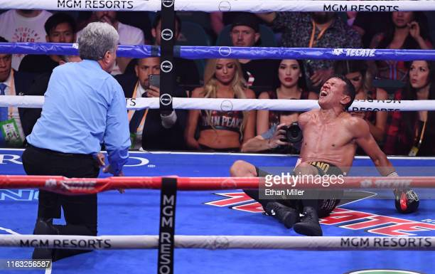 Referee Vik Drakulich checks on Juan Carlo Payano after he was knocked out by Luis Nery in the ninth round of their bantamweight bout at MGM Grand...