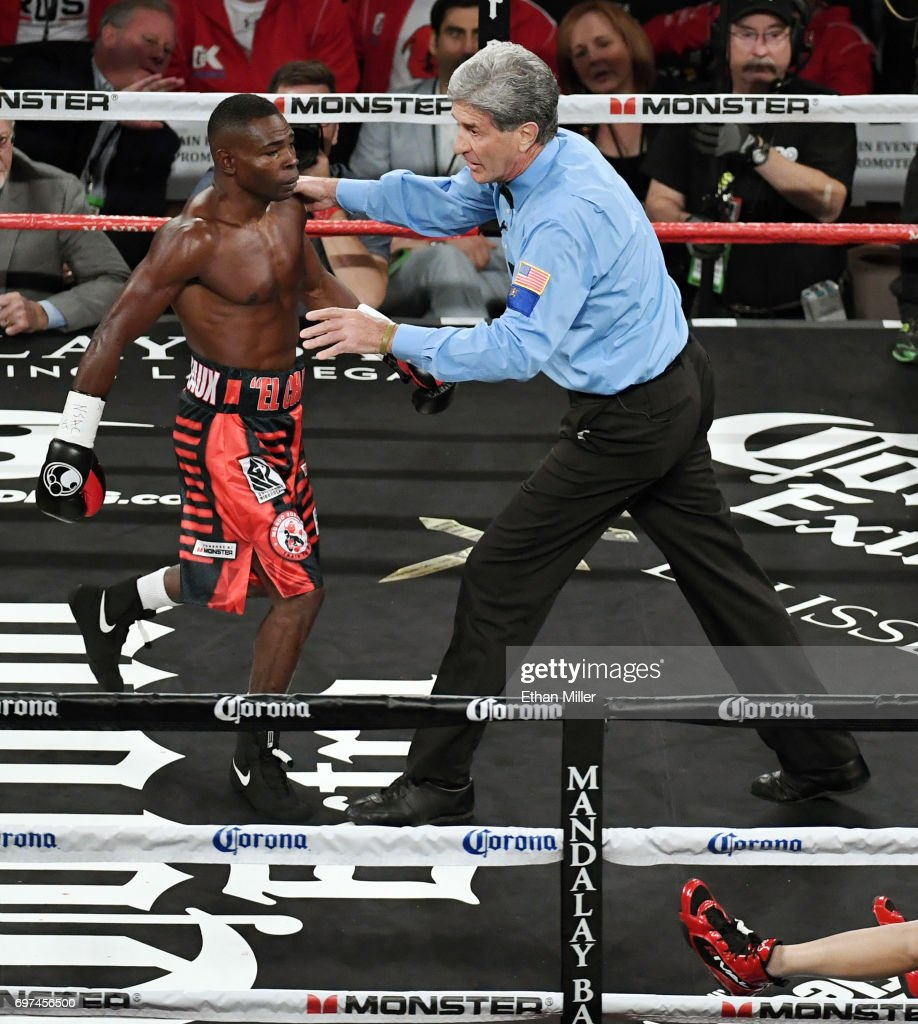 Referee Vik Drakulich (R) sends Guillermo Rigondeaux to a neutral corner after he knocked Moises Flores down at the end of the first round of their super bantamweight championship bout at the Mandalay Bay Events Center on June 17, 2017 in Las Vegas, Nevada. Rigondeaux retained his WBA title with a first-round knockout.