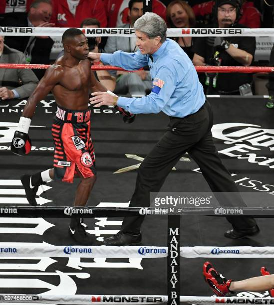 Referee Vik Drakulich sends Guillermo Rigondeaux to a neutral corner after he knocked Moises Flores down at the end of the first round of their super...