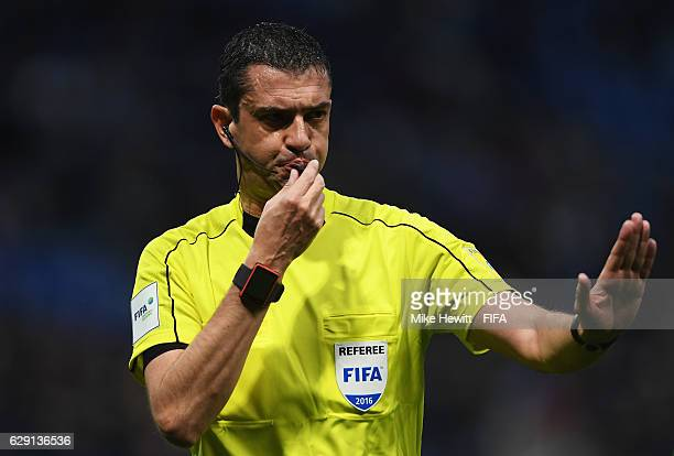 Referee Viktor Kassai blows his whistle during the FIFA Club World Cup second round match between Jeonbuk Hyundai and Club America at Suita City...