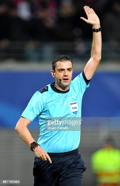 Referee Viktor Kassai disallows a goal during the UEFA Champions League group G match between RB Leipzig and Besiktas at Red Bull Arena on December 6...