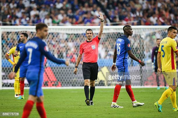 Referee Viktor Kassai during the Euro group stage match between France and Romania at the Stade de France on june 10 2016 in SaintDenis France