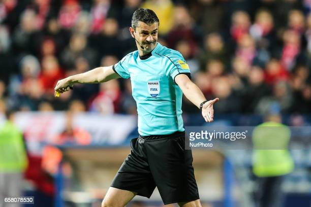 Referee Viktor Kassai during the FIFA World Cup 2018 qualification football match between Montenegro and Poland in Podgorica Montenegro on March 26...