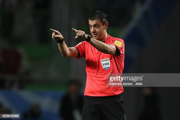 Referee Viktor Kassai gestures during the FIFA Club World Cup Semi Final match between Atletico Nacional and Kashima Antlers at Suita City Football...