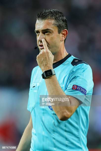 Referee Viktor Kassai gestures during the UEFA Champions League group G soccer match between RB Leipzig and Besiktas at the Leipzig Arena in Leipzig...