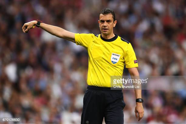 Referee Viktor Kassai gestures during the UEFA Champions League Quarter Final second leg match between Real Madrid CF and FC Bayern Muenchen at...