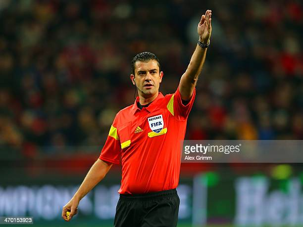 Referee Viktor Kassai gestures during the UEFA Champions League Round of 16 first leg match between Bayer Leverkusen and Paris SaintGermain FC at...