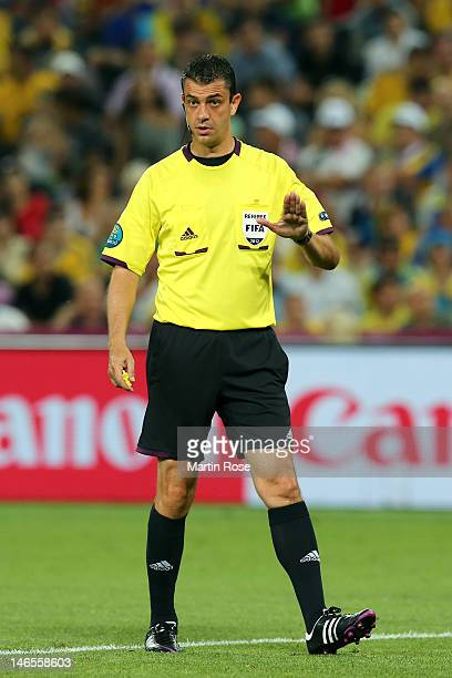 Referee Viktor Kassai gestures during the UEFA EURO 2012 group D match between England and Ukraine at Donbass Arena on June 19 2012 in Donetsk Ukraine