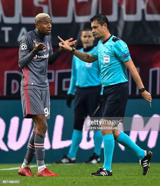 Referee Viktor Kassai gestures towards Besiktas' Brazilian midfielder Talisca after showing him a yellow card following his lengthy celebration after...
