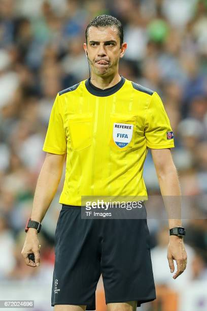 Referee Viktor Kassai looks on during the UEFA Champions League Quarter Final second leg match between Real Madrid CF and FC Bayern Muenchen at...