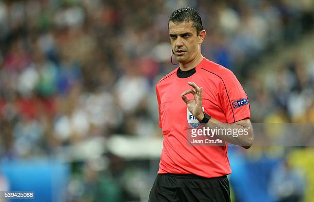 Referee Viktor Kassai of Hungary gestures during the UEFA Euro 2016 Group A opening match between France and Romania at Stade de France on June 10...