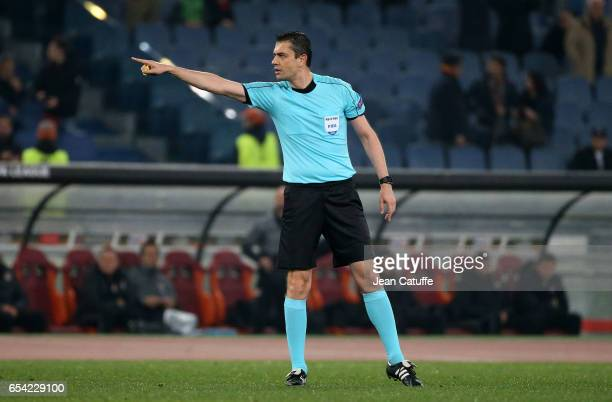 Referee Viktor Kassai of Hungary gestures during the UEFA Europa League Round of 16 second leg match between AS Roma and Olympique Lyonnais at Stadio...