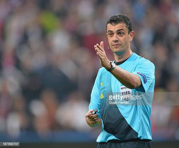 Referee Viktor Kassai points during the UEFA Champions League semi final first leg match between FC Bayern Muenchen and FC Barcelona at Allianz Arena...