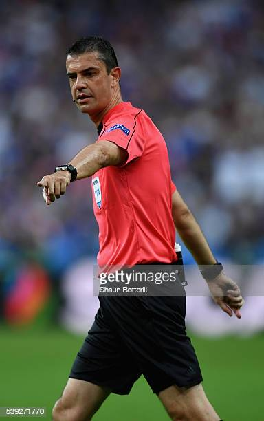 Referee Viktor Kassai points during the UEFA Euro 2016 Group A match between France and Romania at Stade de France on June 10 2016 in Paris France