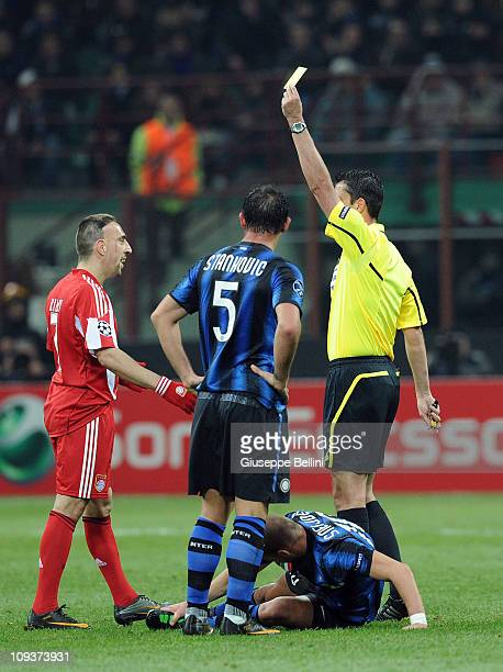 Referee Viktor Kassai shows the yellow card to Franck Ribery of Bayern during the UEFA Champions League round of 16 first leg match between Inter...