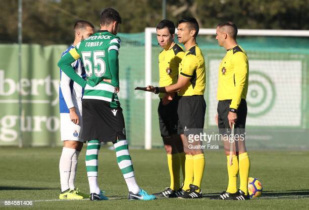 Referee Vitor Ferreira with Sporting CP B defender Tobias Figueiredo and FC Porto midfielder Rui Moreira from Portugal before the start of the...