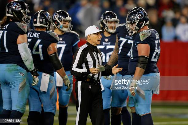 NFL Referee Walt Anderson talks with Tennessee Titans Center Ben Jones during the NFL game between the Tennessee Titans and Indianapolis Colts on...