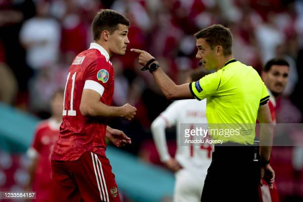Referee warns Roman Zobnin of Russia during the EURO 2020 Group B third match between Russia and Denmark at Parken Stadium in Copenhagen, Denmark on...