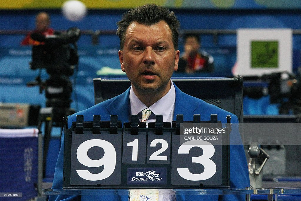 A referee watches a ball fly through the : News Photo