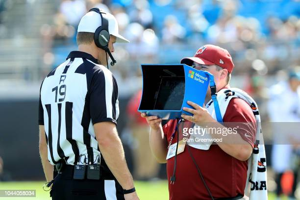 A referee watches a replay during the game between the Jacksonville Jaguars and the New York Jets on September 30 2018 in Jacksonville Florida
