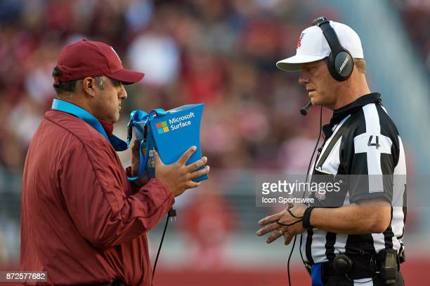 A referee watches footage of an Instant Replay on a Microsoft Surface tablet with a Bose headset during an NFL game between the Arizona Cardinals and...