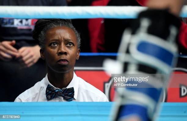 A referee watches the fight in the 'Women K1 48kg category' in the 'BOK' sports hall in Budapest on November 9 2017 during the oneweek long ' World...