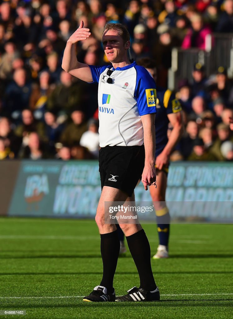 Referee Wayne Barnes shields his eyes from the low sun during the Aviva Premiership match between Worcester Warriors and Bristol Rugby at Sixways Stadium on March 5, 2017 in Worcester, England.