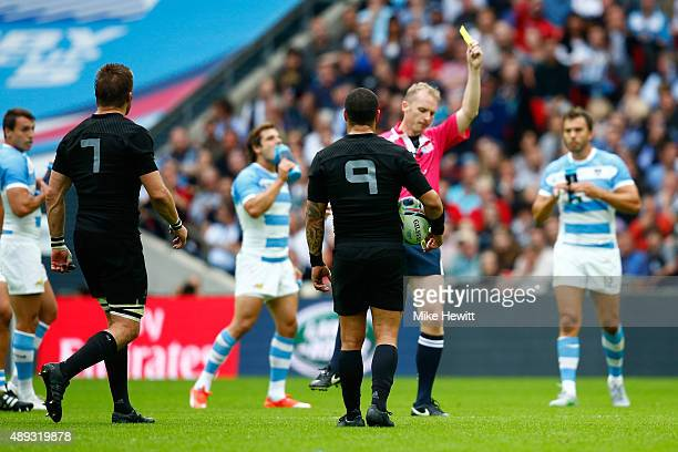 Referee Wayne Barnes shows Richie McCaw of the New Zealand All Blacks a yellow card during the 2015 Rugby World Cup Pool C match between New Zealand...