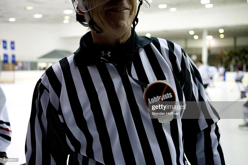 A referee wears a No Lobbyists sticker at the Congressional Hockey Challenge on March 9, 2010 in Washington, DC. The game matches members of Congress and Congressional staff against lobbyists for major corporations as a benefit for the Fort Dupont Ice Hockey Club.