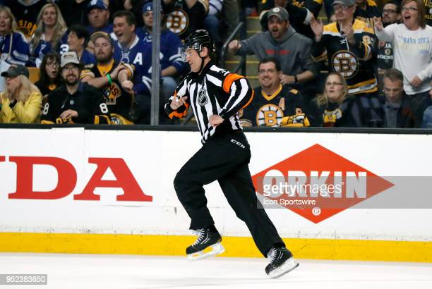 Referee Wes McCauley has a chuckle after catching an edge and wiping out during Game 7 of the First Round for the 2018 Stanley Cup Playoffs between...