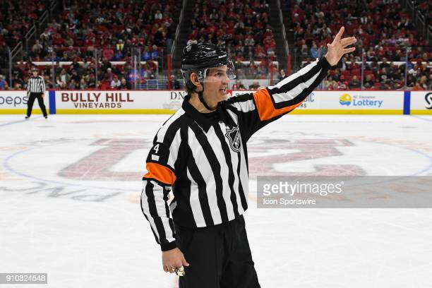 NHL referee Wes McCauley makes a call during a game between the Vegas Golden Knights and the Carolina Hurricanes at the PNC Arena in Raleigh NC on...