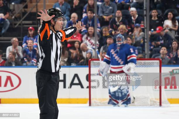 Referee Wes McCauley makes a call for no goal after a video review in the first period between the New York Rangers and the Montreal Canadiens at...