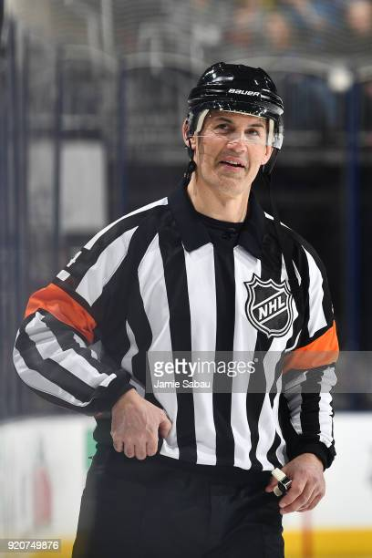 NHL referee Wes McCauley officiates the game between the Philadelphia Flyers and the Columbus Blue Jackets on February 16 2018 at Nationwide Arena in...