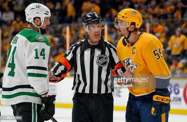 Referee Wes McCauley separates Roman Josi of the Nashville Predators and Jamie Benn of the Dallas Stars after a whistle in Game Five of the Western...