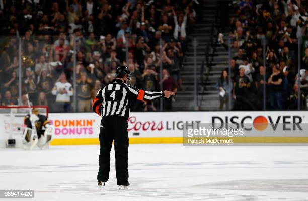 NHL referee Wes McCauley signals goal after a challenge by Washington Capitals on a goal by Vegas Golden Knights in the second period of Game Five of...