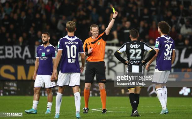 Referee Wesley Alen gives Philippe Sandler of Anderlecht a yellow card during the Jupiler Pro League match between Sporting Charleroi and RSC...