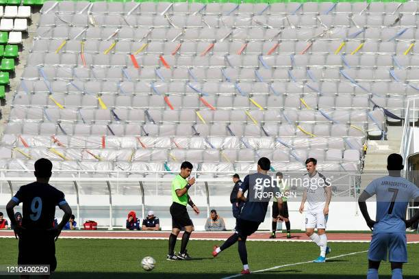 Referee whistles the kick-off at the start of the Turkmenistan national football championship match between Altyn Asyr and Kopetdag on April 19 amid...